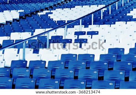 amphitheater of dark blue seats abstract background - stock photo