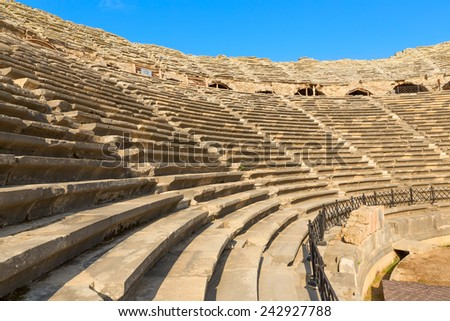 Amphitheatre with lots empty seats, ancient ruins in Side Turkey. - stock photo