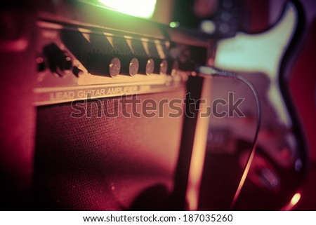 Amplifier and electric guitar - stock photo