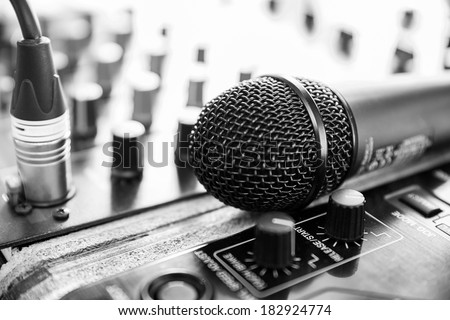 Amplifier close up and microphone -  black and white photo - stock photo