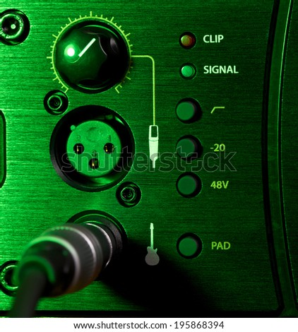 amplifier control panel with knobs, close up
