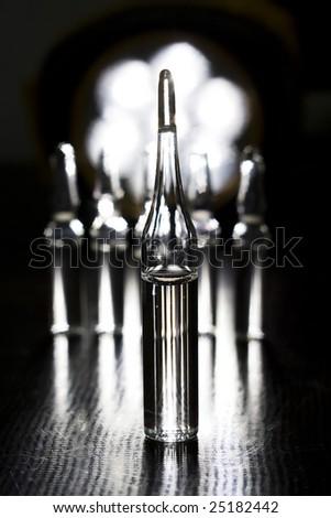 ampule in black - stock photo
