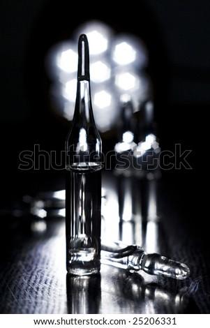 Ampules in black - stock photo