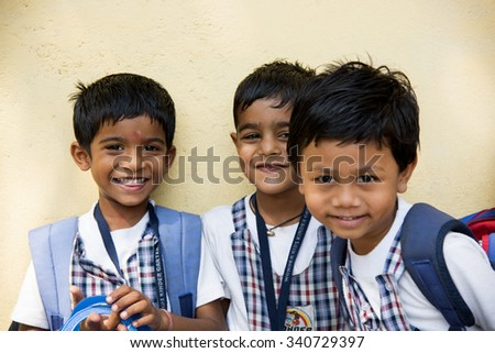AMRAVATI, INDIA - October 10, 2015:  Happy small children dressed With bag in kindergarten, Amravati , Maharashtra, India