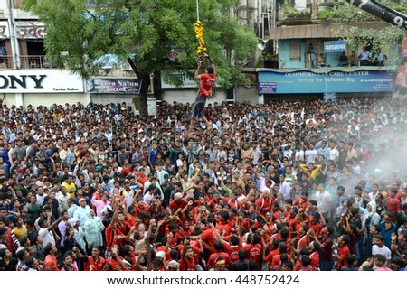 "AMRAVATI, MAHARASHTRA, INDIA - AUGUST 29 : Crowd of young People enjoying ""Govinda"" the Dahi Handi festival to celebrate God Krishna's Birth in Amravati, Maharashtra, India. 29 August 2013"