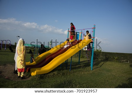AMRAVATI, MAHARASHTRA, INDIA - 15 AUGUST 2017 : Unidentified children  having fun and playing in park and in morning at holiday.