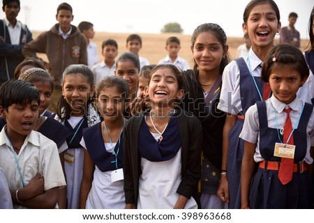 AMRAVATI, MAHARASHTRA, INDIA -  FEBRUARY 5 : Happy Indian rural school boy and girl at their school,  Amravati , Maharashtra, India 5 February 2016. - stock photo