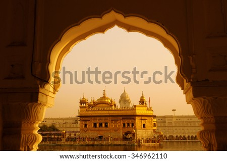 Amritsar Golden Temple - India. Framed with windows from west side. focus on temple - stock photo