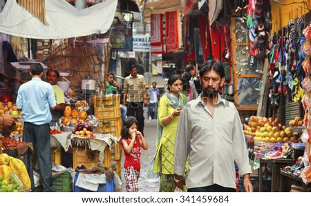 AMRITSAR/INDIA - JUNE 18. Indian city street full of people in market place on June 18, 2015 in Amritsar, Punjab, India. - stock photo