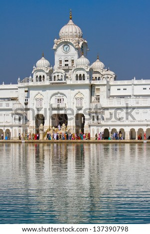 AMRITSAR, INDIA - OCTOBER 19: Sikh pilgrims in the Golden Temple during celebration day in October 19, 2012 in Amritsar, Punjab, India. Harmandir Sahib is the holiest pilgrim site for the Sikhs. - stock photo