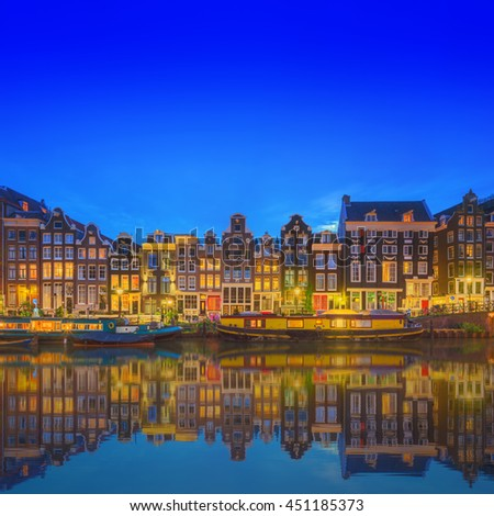 Amstel river, canals and night view of beautiful Amsterdam city. Netherlands