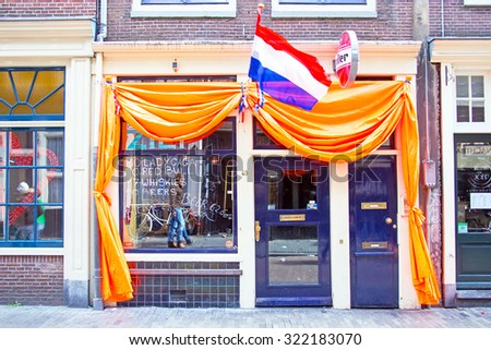 AMSTERDAM - APR 27: Decorated dutch cafe in Amsterdam at Kings Day on April 27. 2015 in the Netherlands - stock photo