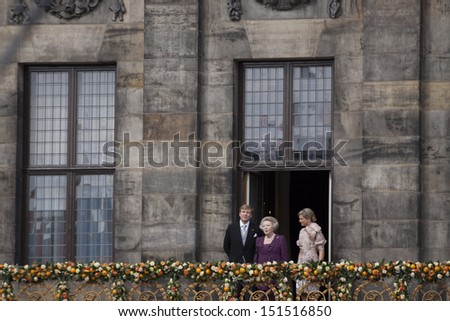 AMSTERDAM - APR 30:  King Willem-Alexander, Queen Maxima and Princess Beatrix from the balcony of the palace after the accession of the throne on April 30, 2013 in Amsterdam.