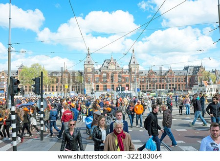 AMSTERDAM APR 27: People at the Central Station on Kings Day in Amsterdam on April 27. 2015 in the Netherlands - stock photo