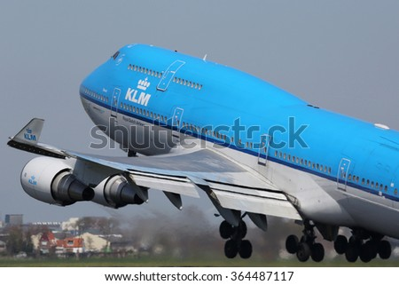 AMSTERDAM - APRIL 21: A KLM Royal Dutch Airlines Boeing 747-400 taking off on April 21, 2015 in Amsterdam. KLM is the largest airline of the Netherlands with its hub at Amsterdam airport.
