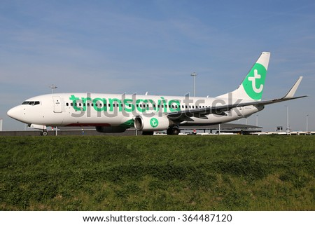 AMSTERDAM - APRIL 21: A Transavia Airlines Boeing 737-800 taxis on April 20, 2015 in Amsterdam. Transavia is a low-cost airline from the Netherlands, owned by Air France KLM.