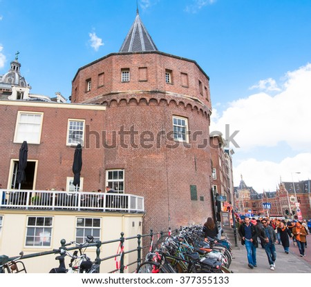 AMSTERDAM-APRIL 27:  Amsterdam cityscape during King's Day with Schreierstoren in the background on April 27,2015, Netherlands. The Schreierstoren (Weeper's Tower) was part of the medieval city wall.