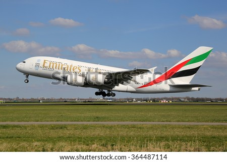 AMSTERDAM - APRIL 19: An Emirates Airbus A380 taking off on April 19, 2015 in Amsterdam. The Airbus A380 is the world's largest passenger airliner. Emirates is a airline based in Dubai, Arab Emirates. - stock photo