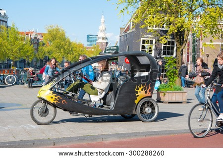 Amsterdam-April 30: Bicycle taxi in downtown of Amsterdam on April 30, 2015, the Netherlands. - stock photo