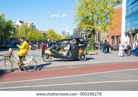 Amsterdam-April 30: Bicycle taxi in the centre of Amsterdam on April 30, 2015, the Netherlands. - stock photo