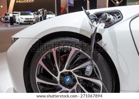 AMSTERDAM - APRIL 16, 2015: BMW plug-in hybrid charging at the AutoRAI 2015 - stock photo