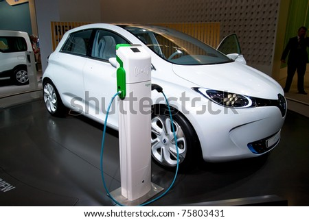 AMSTERDAM - APRIL 22 - Electric Renault Zoe concept car next to a charger pole, on display at the AutoRAI motorshow. April 22, 2011 in Amsterdam, The Netherlands. - stock photo