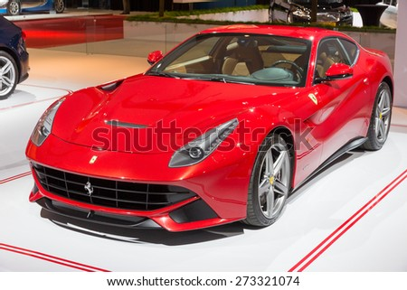 AMSTERDAM - APRIL 16, 2015: Ferrari F12 Berlinetta sports car at the AutoRAI 2015. The F12 debuted in 2012 and replaces the 599 series grand tourers. - stock photo