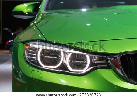 AMSTERDAM - APRIL 16, 2015: Front headlight of the BMW M3 at the AutoRAI 2015.