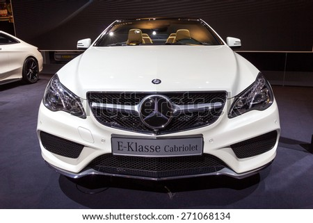 AMSTERDAM - APRIL 16, 2015: Mercedes-Benz E-Class Cabriolet car at the AutoRAI 2015. E-class is a range of executive cars manufactured by Mercedes-Benz in various configurations produced since 1993. - stock photo