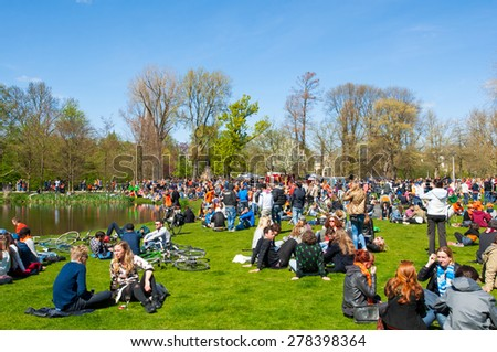AMSTERDAM-APRIL 27: People in Vondelpark during King's Day on April 27,2015, the Netherlands.King's Day is the largest open-air festivity in Amsterdam, the Netherlands.