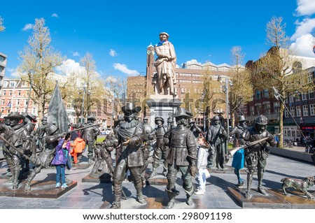 Amsterdam-April 30: Rembrandtplein with a bronze-cast representation The Night Watch, by Russian artists Mikhail Dronov and Alexander Taratynov on April 30, 2015, the Netherlands. - stock photo