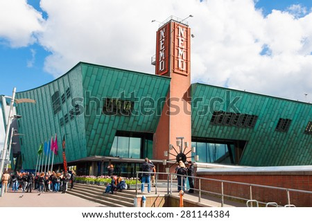 AMSTERDAM-APRIL 27: Science Center and Museum Nemo, people go sightseeing on April 27,2015 in Amsterdam, the Netherlands. Science Center Nemo is a science center in Amsterdam.  - stock photo