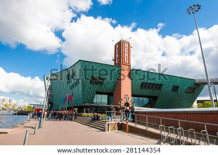 AMSTERDAM-APRIL 27: Science Center and Museum Nemo, people go sightseeing on April 27,2015. Science Center Nemo is a science center in Amsterdam, Netherlands.  - stock photo