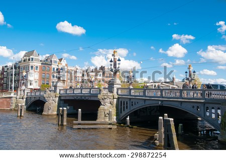 "Amsterdam-April 30: The Blauwbrug on April 30,2015, the Netherlands. The Blauwbrug or ""blue bridge"" is an historic bridge connecting the Rembrandtplein area with the Waterlooplein area. - stock photo"