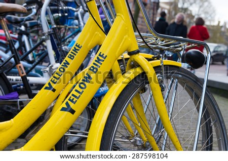 AMSTERDAM - APRIL 4, 2015: Two rental bikes waiting for customers. The number of bicycles equal the number of residents in the dutch capital - stock photo