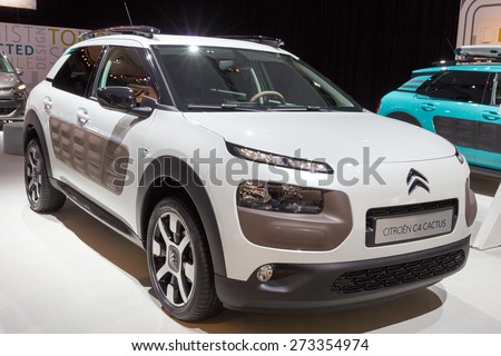 AMSTERDAM - APRIL 16, 2015: White Citroen C4 Cactus at the AutoRAI 2015. Visible is the unique â??Airbumpâ? panels on the car's sides, designed to protect the vehicle from damage in car parks.  - stock photo