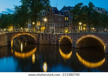 Amsterdam at night in the blue hour - stock photo