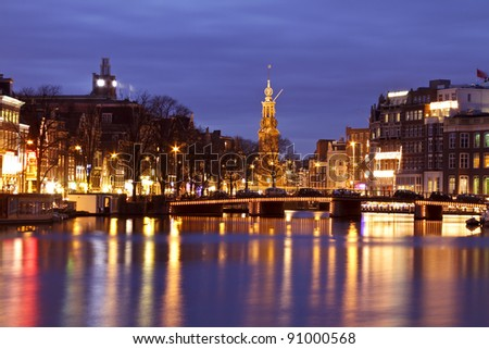 Amsterdam at night with the Munttower in the Netherlands