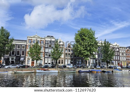 AMSTERDAM-AUG. 18, 2012. Ancient gabled houses on Aug. 18, 2012 in Amsterdam. It is known as Venice of the North, its beautiful canal belt was finally added to the world heritage list in July 2010. - stock photo