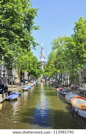 AMSTERDAM-AUG. 19, 2012. Canal with ancient houses on Aug. 19, 2012 in Amsterdam. It is known as Venice of the North, its beautiful canal belt was finally added to world heritage list in July 2010. - stock photo
