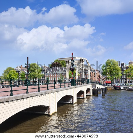 AMSTERDAM-AUG. 19. 2012. Famous Magere Brug over the river Amstel in historical canal belt. Because the bridge is very narrow, the locals called it Magere Brug, which literally means skinny bridge. - stock photo
