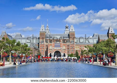 AMSTERDAM-AUG. 24, 2014. View on renovated Rijksmuseum (State Museum). It has 8,000 art and history objects on display, among which are masterpieces by Rembrandt, Frans Hals, and Johannes Vermeer. - stock photo