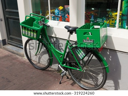 AMSTERDAM - AUGUST 2, 2015: Heineken bicycle in front of the heineken brand store. The Heineken Brand Store is the official store of Heineken with more than 250 unique Heineken products and a Beershop - stock photo