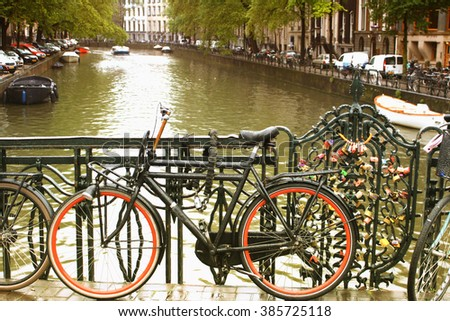 Amsterdam, August 15. 2015 - Orange Bike on day light during the rain. - stock photo