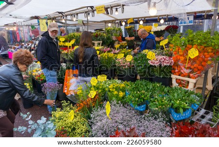 AMSTERDAM - AUGUST 30: People buy flowers at the flower market on August 30, 2014 in Amsterdam. - stock photo