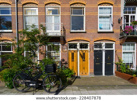 AMSTERDAM - AUGUST 26: Typical Dutch facade in old city at daytime on August 26, 2014 in Amsterdam.