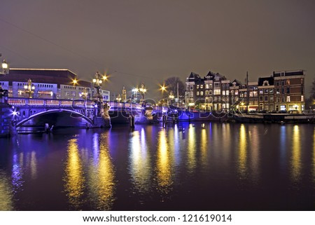 Amsterdam by night with the Blue Bridge at the Amstel in the Netherlands