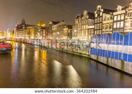 Amsterdam canal and the flower market at night - stock photo