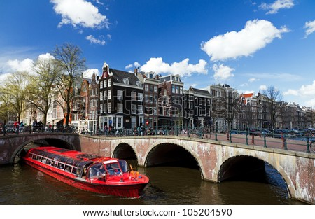 Amsterdam canal boat - stock photo
