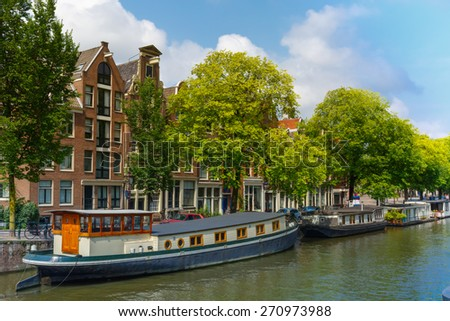 Amsterdam canal with houseboats, Holland - stock photo